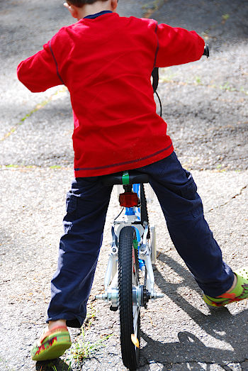 Child on bike pushing without pedals